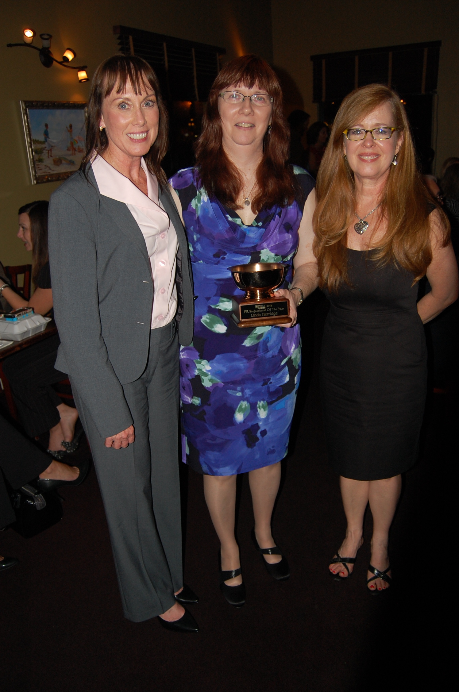 Suzanne Sparling, APR, CPRC, Linda Herridge - PR Professional of the Year and Lisa Malone, APR, CPRC